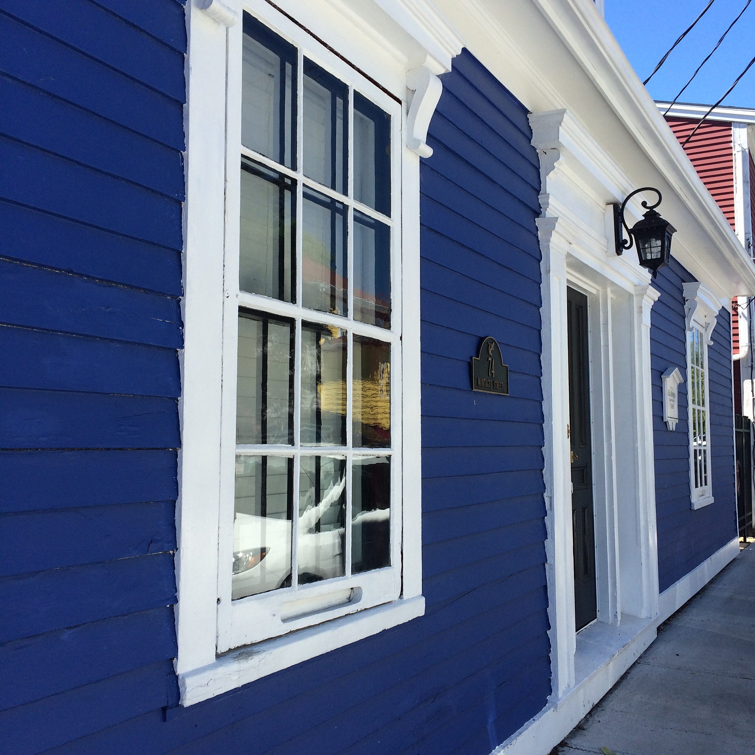 blue, the colour suits you – blue house red barn