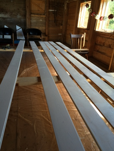 Painting shiplap in the barn